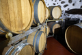 Close-up of Many Wooden Barrels in oak Stored At Wine Cellar - PhotoDune Item for Sale