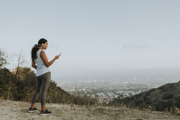 Cheerful woman using a mobile phone - Stock Photo - Images