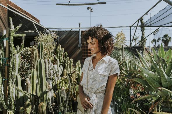 Beautiful woman at a cactus garden - Stock Photo - Images
