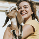 Portrait of a beautiful young woman with a goat - PhotoDune Item for Sale