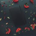 Closed black moleskin notebook flat lay - PhotoDune Item for Sale