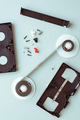 Flat lay vhs video cassette parts on pastel blue background - PhotoDune Item for Sale