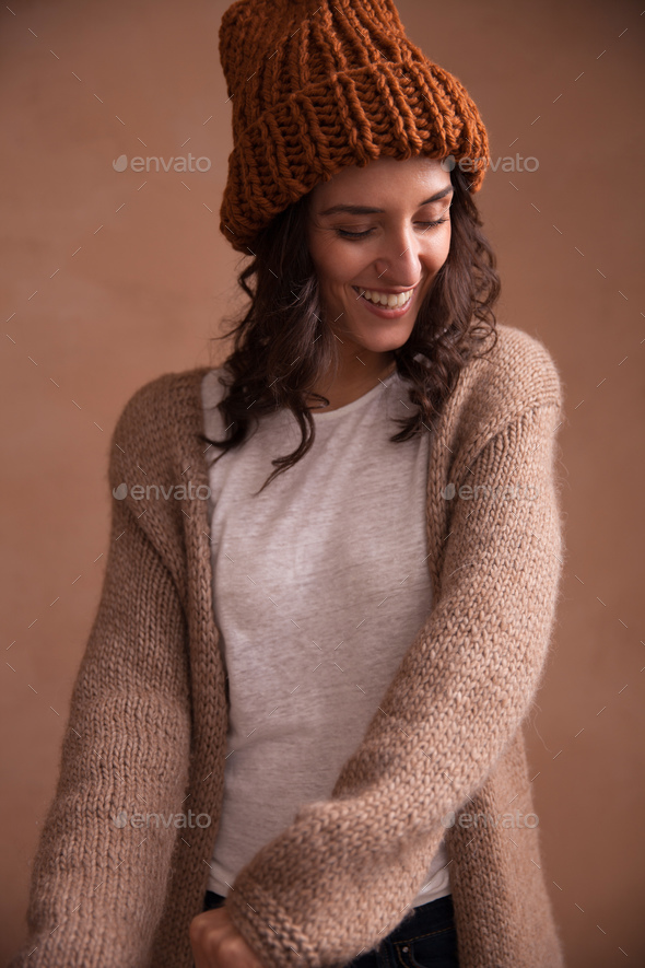 Happy woman in knitted sweater and hat - Stock Photo - Images