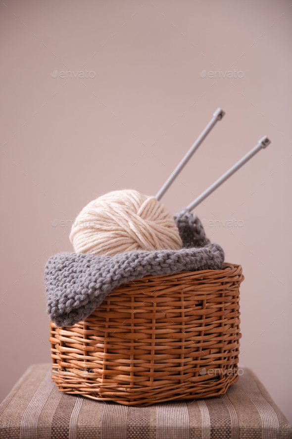 Basket witn yarn clew and knitting needles - Stock Photo - Images