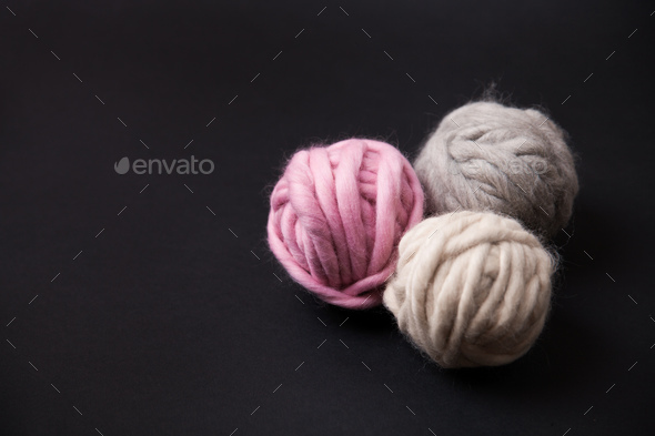 Colorful yarn clews on black background - Stock Photo - Images