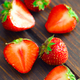 Slices of strawberry on wooden  table background - PhotoDune Item for Sale