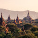 Landscape view of ancient temples at colorful golden sunset, Bagan, Myanmar - PhotoDune Item for Sale