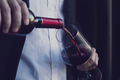 Man pouring red wine into a glass - PhotoDune Item for Sale