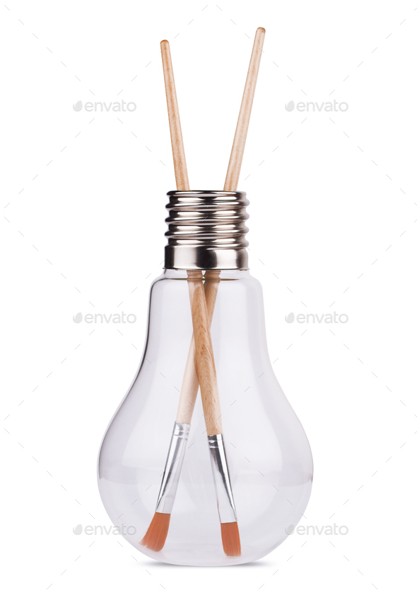 light bulb with two painting brushes inside on white - Stock Photo - Images