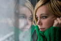 Beautiful blonde woman with sweater in front of a window - PhotoDune Item for Sale