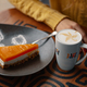 Slice of delicious carrot cheesecake and latte cup - PhotoDune Item for Sale