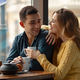 Young couple in love sitting in a cafe, drinking coffee - PhotoDune Item for Sale