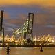 Industrial harbor landscape with  two loading cranes at night - PhotoDune Item for Sale