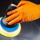 Close-up view of a hands in orange gloves holding buffer - PhotoDune Item for Sale