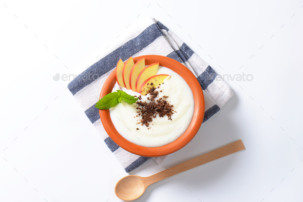 Semolina or rice pudding with apple and chocolate - Stock Photo - Images