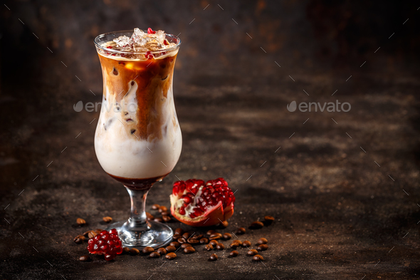 Iced coffee latte with pomegranate syrup - Stock Photo - Images