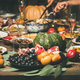 Friends or family eating different snacks at Festive Christmas table - PhotoDune Item for Sale