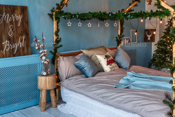 Room, decorated for christmas with: bed, tree with presents and toys and lights - Stock Photo - Images