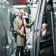 Mature businessman with suitcase travelling by subway in city. - PhotoDune Item for Sale