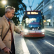Mature businessman with suitcase waiting for a tram in the evening. - PhotoDune Item for Sale