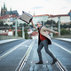 A happy mature businessman with suitcase crossing a road in Prague city. - PhotoDune Item for Sale