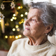 A portrait of a senior woman in wheelchair at home at Christmas time. - PhotoDune Item for Sale
