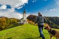 Man walking toward rural church in Slovenia - PhotoDune Item for Sale