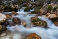 Water flow in wild mountain creek, long exposure - PhotoDune Item for Sale