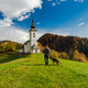 Man walking toward rural church in Slovenia - PhotoDune Item for Sale
