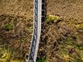 Wooden bridge over dry grassland,aerial view. Zelenci,Slovenia - PhotoDune Item for Sale