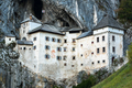 Famous Predjama castle in the mountain, build inside the rock, S - PhotoDune Item for Sale