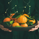 Fresh tangerine fruit in plate in female hands - PhotoDune Item for Sale
