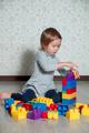 Child girl having fun and build of plastic construction blocks - PhotoDune Item for Sale