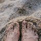 Woman feet in sand. Summer vacation concept - PhotoDune Item for Sale