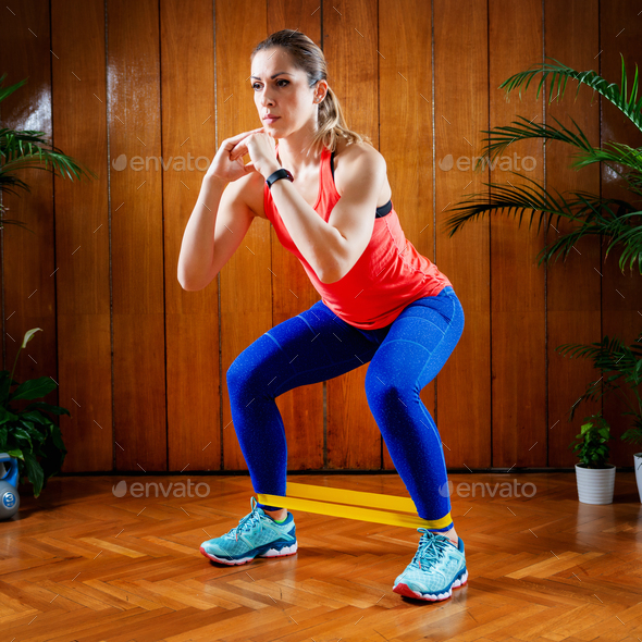 Woman Exercising With Elastic Band - Stock Photo - Images
