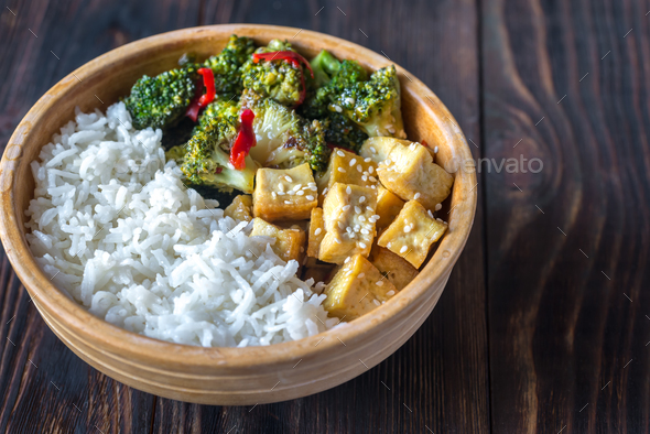 Tofu and broccoli stir-fry with white rice - Stock Photo - Images