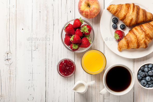 Breakfast with croissants, coffee, jams and berries  - Stock Photo - Images