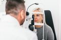 Woman undergoing eyesight exam in optician's office. - PhotoDune Item for Sale