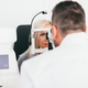Doctor checking his patient's eyesight. - PhotoDune Item for Sale