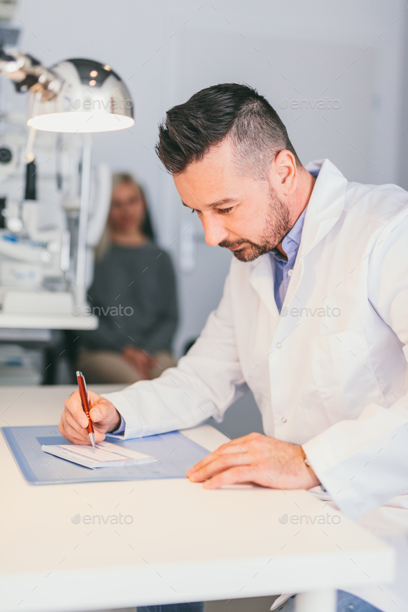 Optician perscribing a treatment for a woman. - Stock Photo - Images