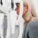Woman taking eyesight test at optician's office. - PhotoDune Item for Sale