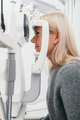 Woman taking eyesight test at optician's office. - PhotoDune Item for Sale