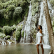 Female tourist enjoying waterfall - PhotoDune Item for Sale