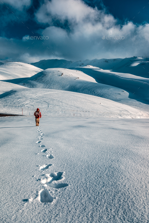 Man in the snowy mountains - Stock Photo - Images