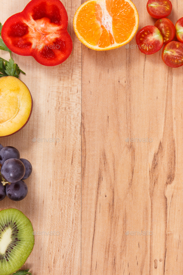 Frame of fresh ripe fruits and vegetables as healthy eating, place for inscription on plank - Stock Photo - Images