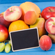 Nutritious fruits as healthy dessert containing natural vitamins, place for text on black board - PhotoDune Item for Sale