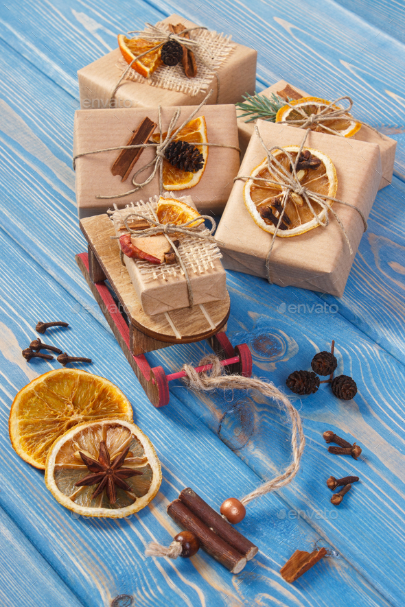 Wooden sled, wrapped gifts with decoration for Christmas or other celebration - Stock Photo - Images