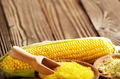 Bowl of corn grits corncob and corn flour on kitchen table - PhotoDune Item for Sale