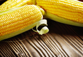 Ripe fresh organic sweet corncobs on wooden table - PhotoDune Item for Sale