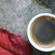 Coffee and red leave on concrete floor. - PhotoDune Item for Sale